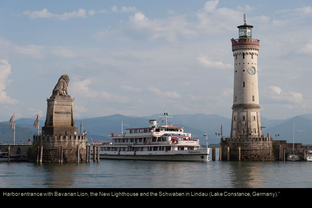Harbor entrance with Bavarian Lion, the New Lighthouse and the Schwaben in Lindau (Lake Constance, Germany).