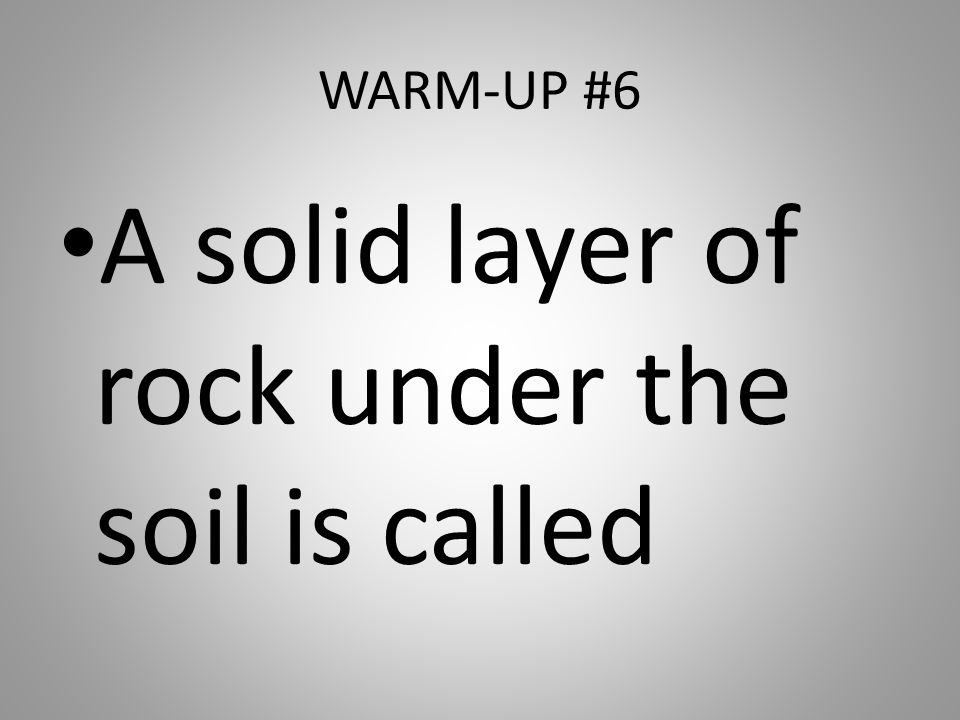 A solid layer of rock under the soil is called