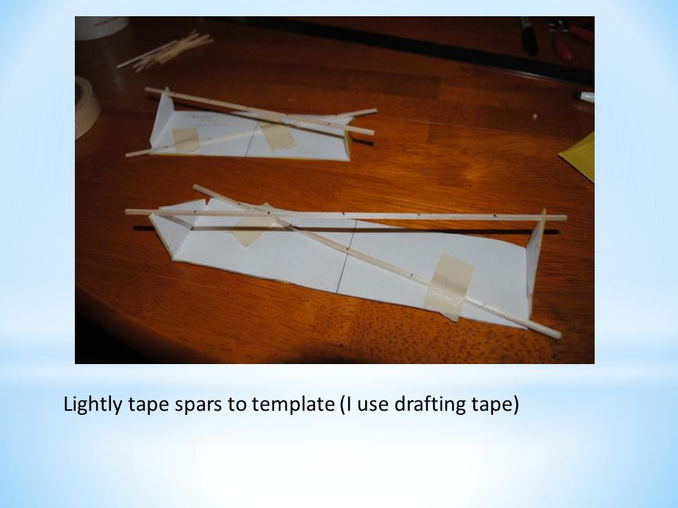 Lightly tape spars to template (I use drafting tape)