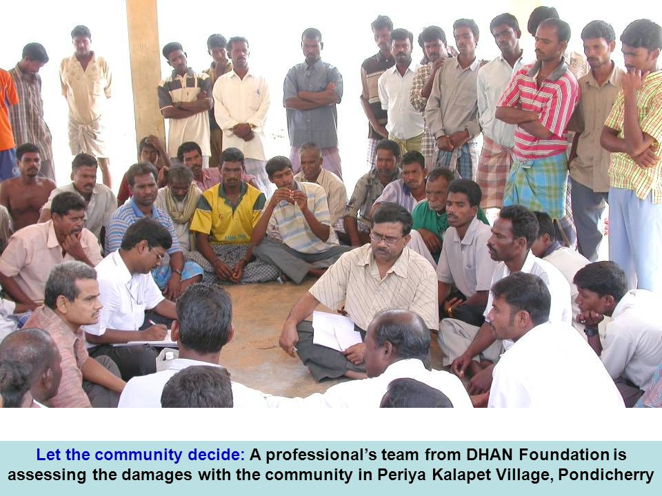Let the community decide: A professional's team from DHAN Foundation is assessing the damages with the community in Periya Kalapet Village, Pondicherry