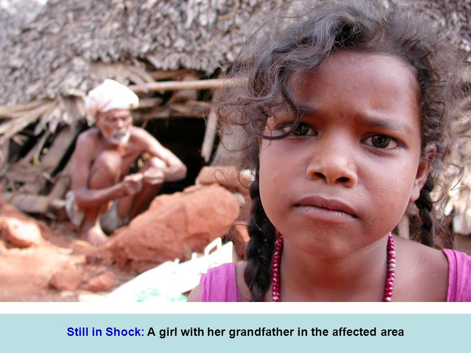 Still in Shock: A girl with her grandfather in the affected area