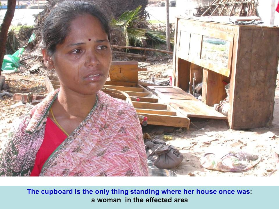 The cupboard is the only thing standing where her house once was: a woman in the affected area