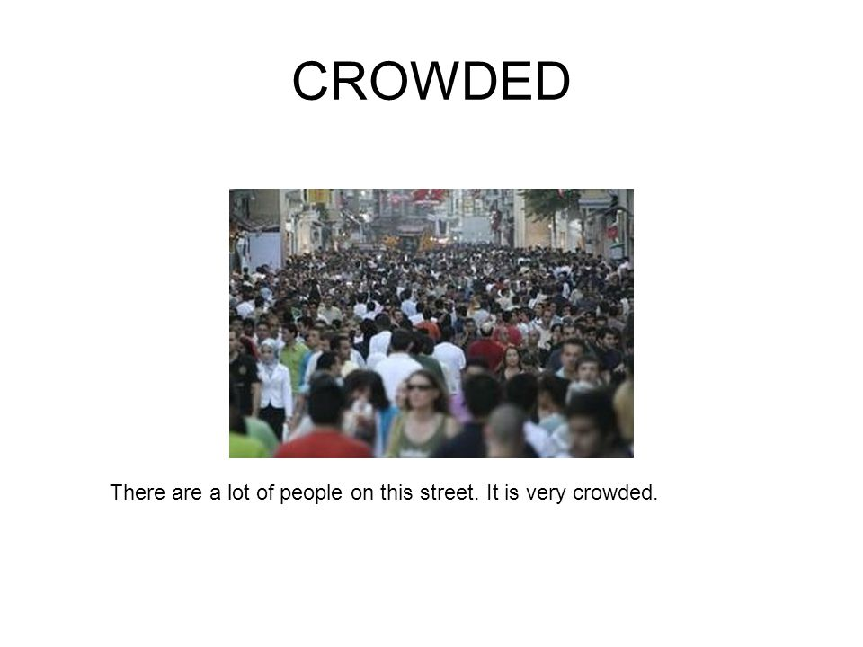 CROWDED There are a lot of people on this street. It is very crowded.