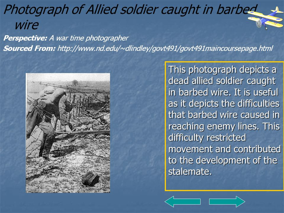 Photograph of Allied soldier caught in barbed wire