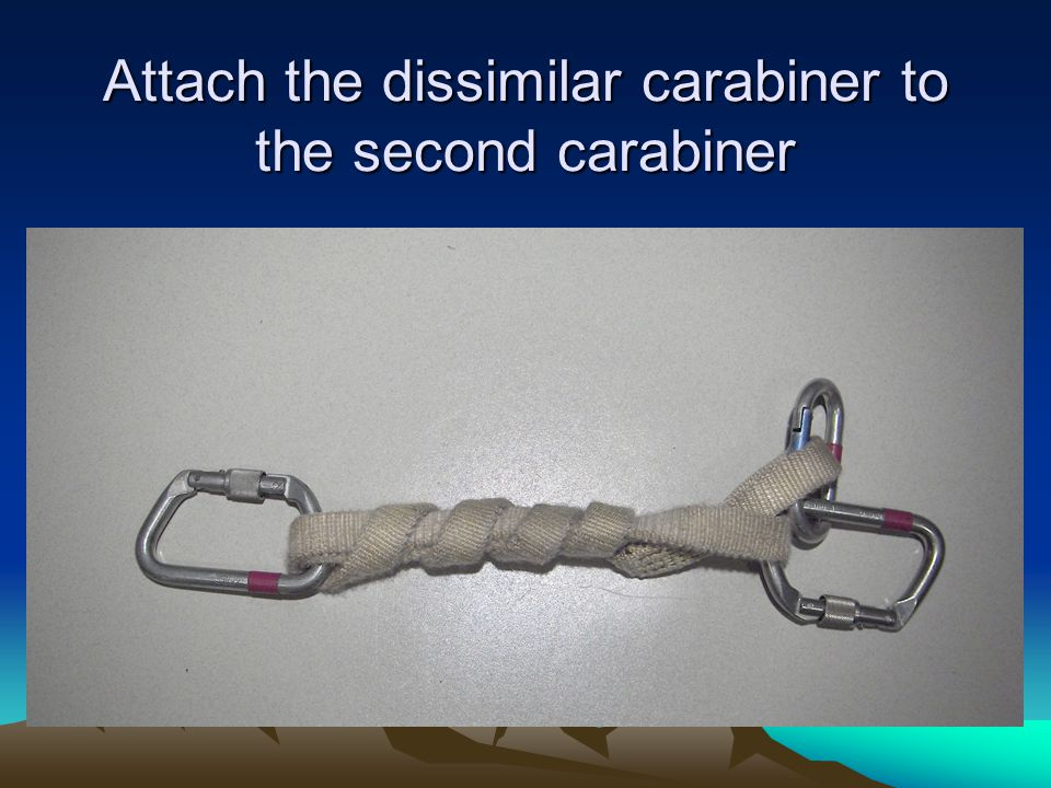 Attach the dissimilar carabiner to the second carabiner