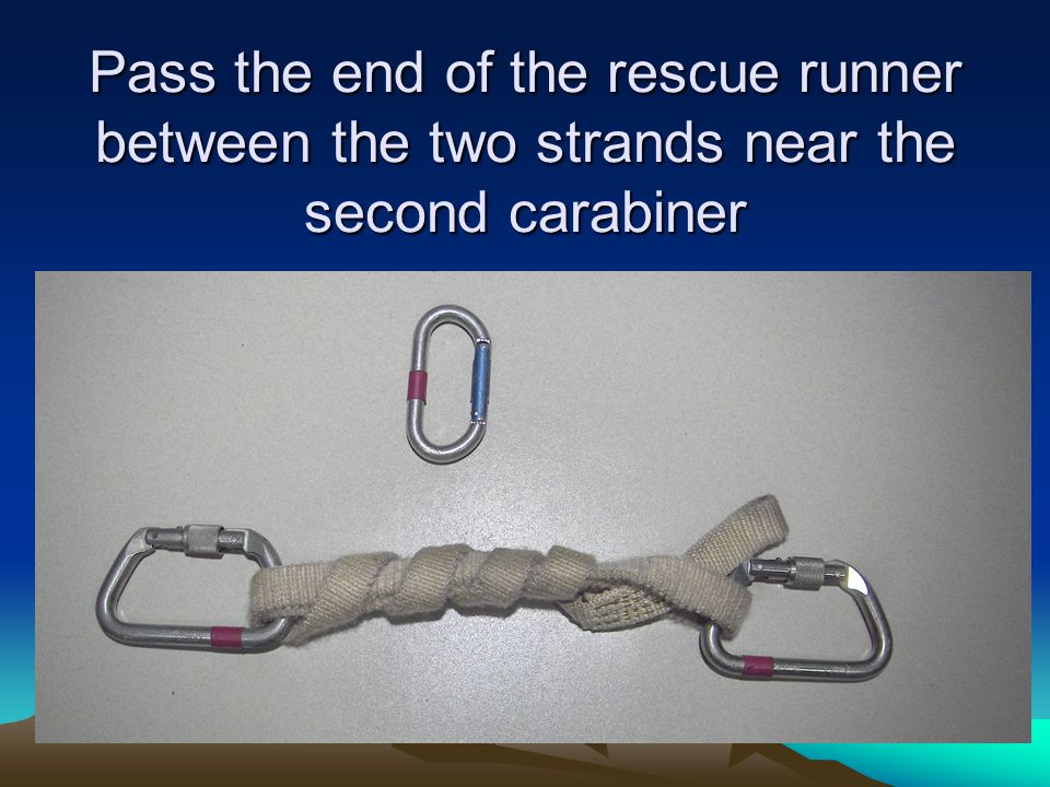 Pass the end of the rescue runner between the two strands near the second carabiner