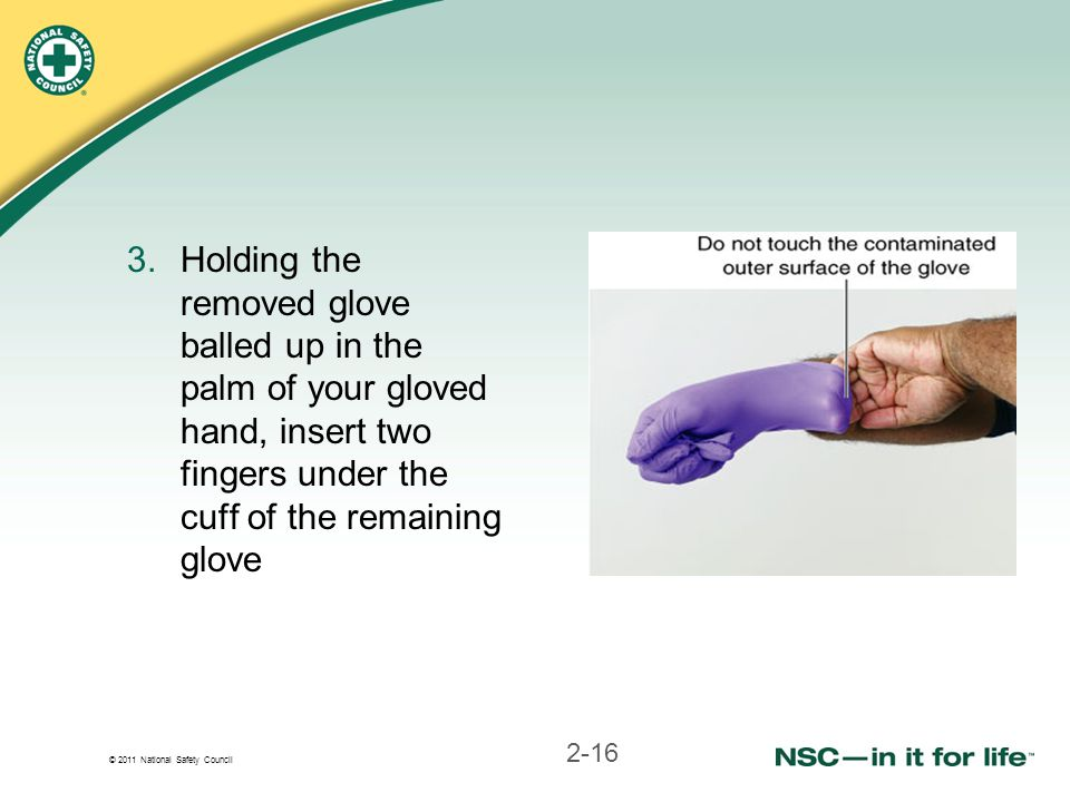 Holding the removed glove balled up in the palm of your gloved hand, insert two fingers under the cuff of the remaining glove