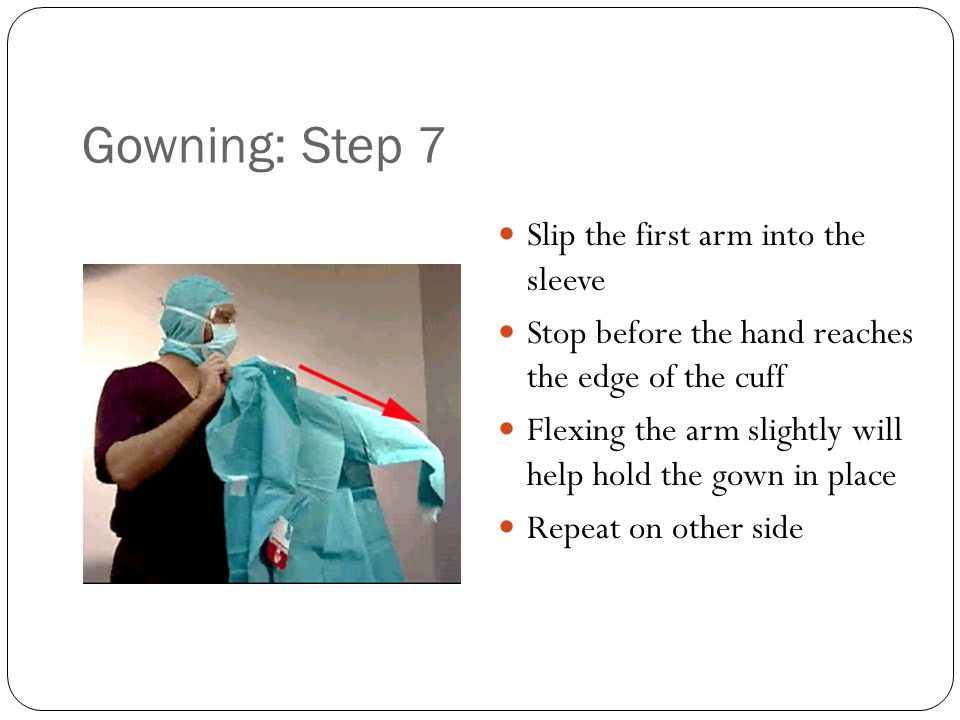 Gowning: Step 7 Slip the first arm into the sleeve