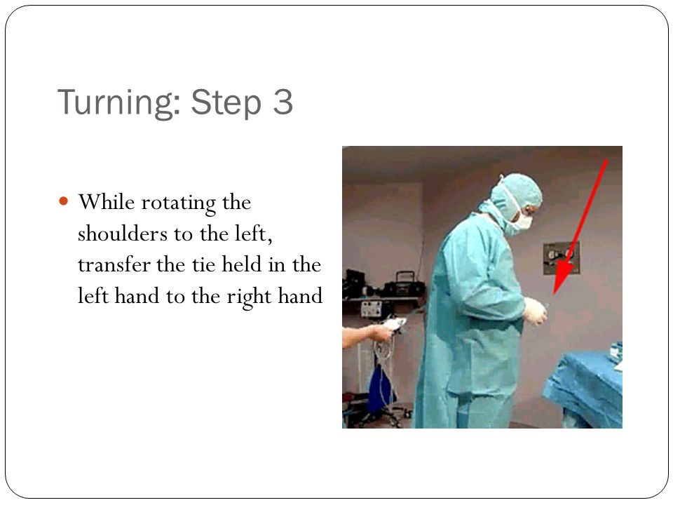 Turning: Step 3 While rotating the shoulders to the left, transfer the tie held in the left hand to the right hand.