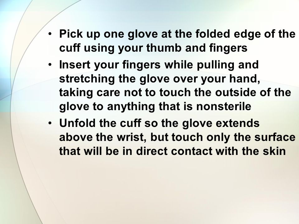 Pick up one glove at the folded edge of the cuff using your thumb and fingers