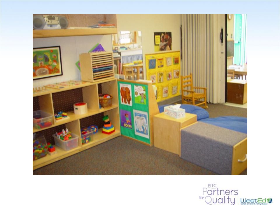 This room allows for child choice of materials and displays art and books at child eye-level.