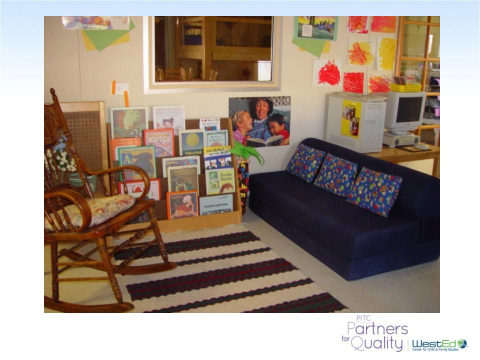 Here is an inviting book area with comfortable seating to the children and the adults.