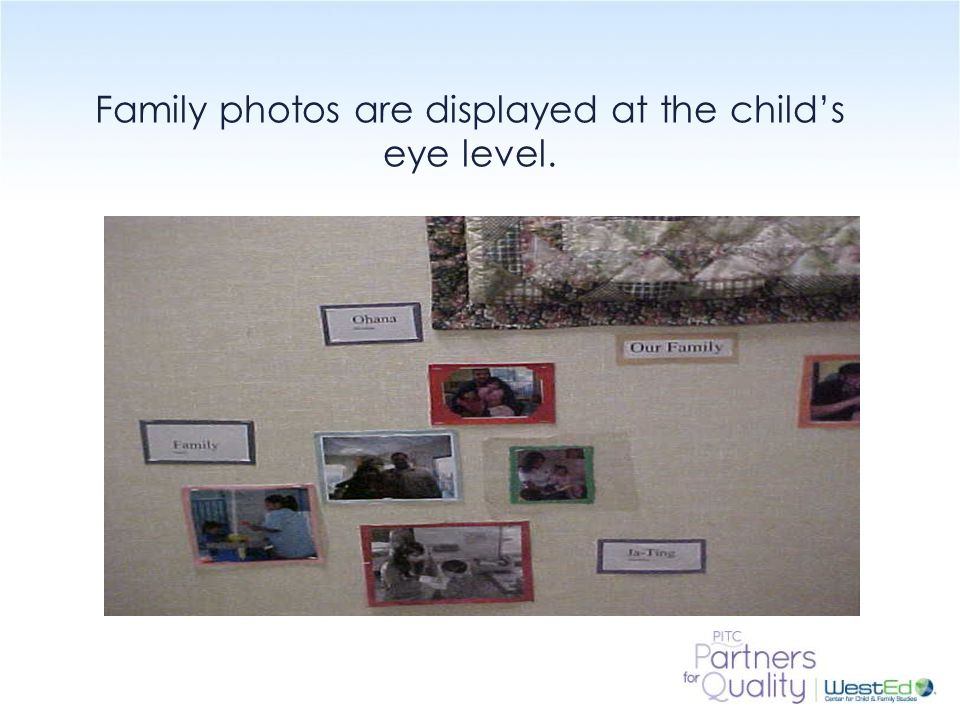 Family photos are displayed at the child's eye level.