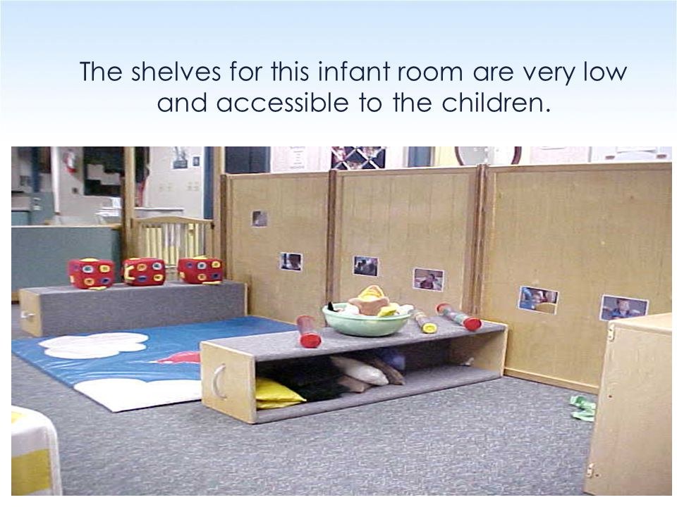 The shelves for this infant room are very low and accessible to the children.
