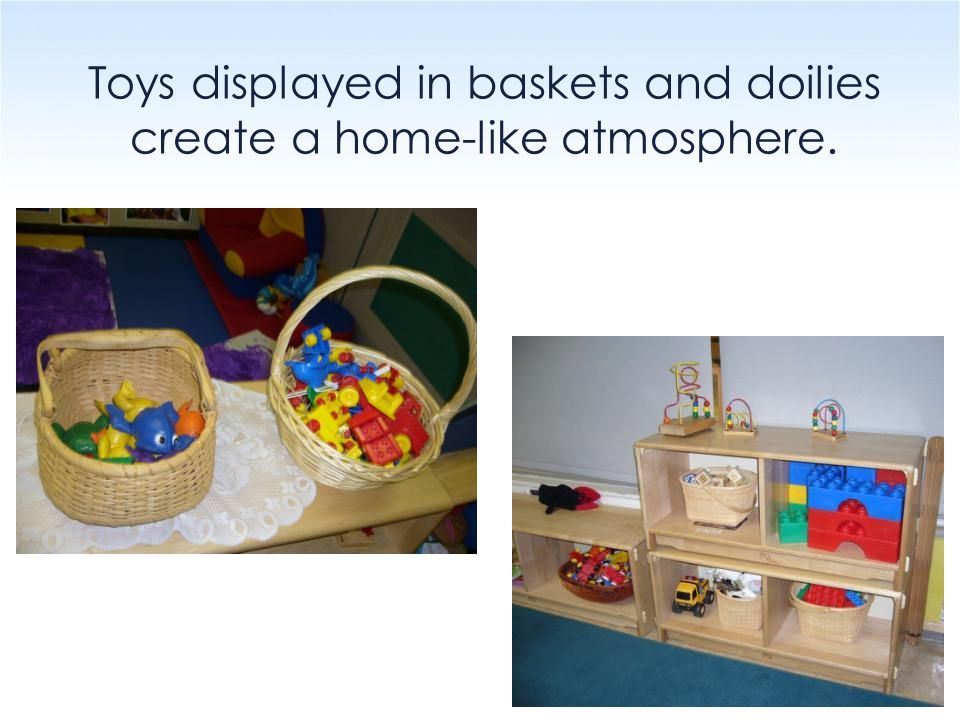 Toys displayed in baskets and doilies create a home-like atmosphere.