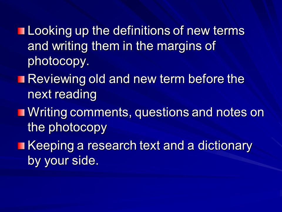Looking up the definitions of new terms and writing them in the margins of photocopy.