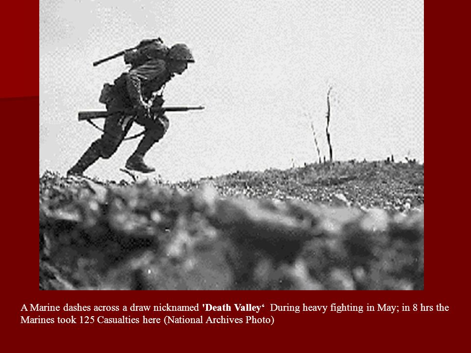 A Marine dashes across a draw nicknamed Death Valley' During heavy fighting in May; in 8 hrs the Marines took 125 Casualties here (National Archives Photo)