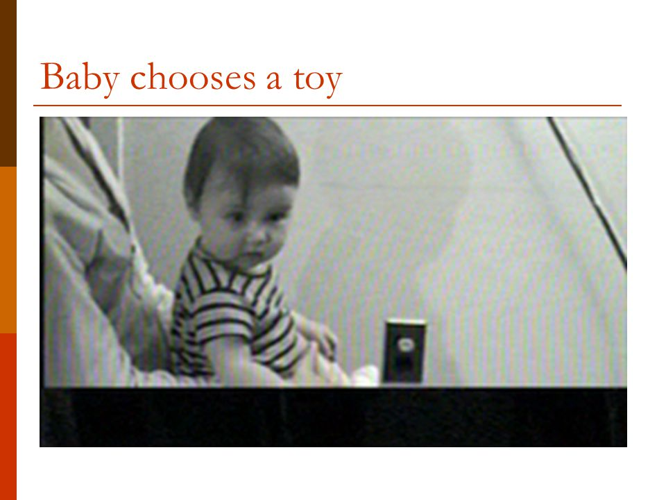 Baby chooses a toy