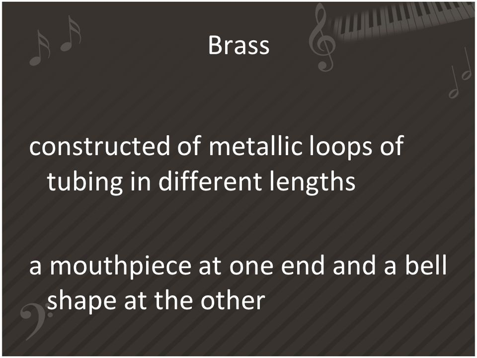 Brass constructed of metallic loops of tubing in different lengths a mouthpiece at one end and a bell shape at the other