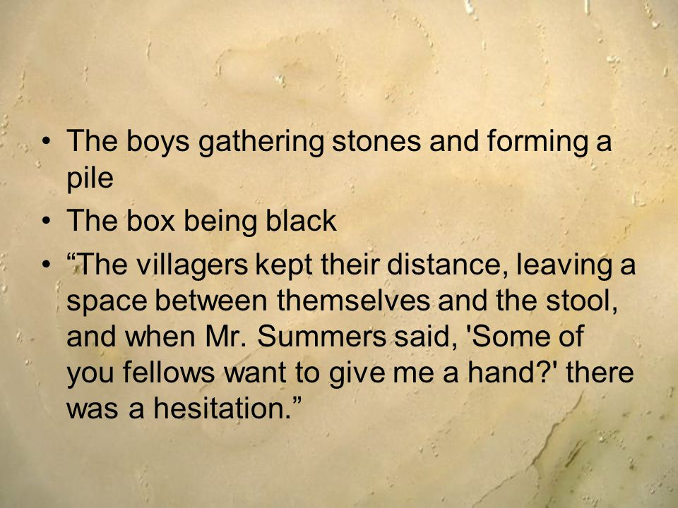 The boys gathering stones and forming a pile