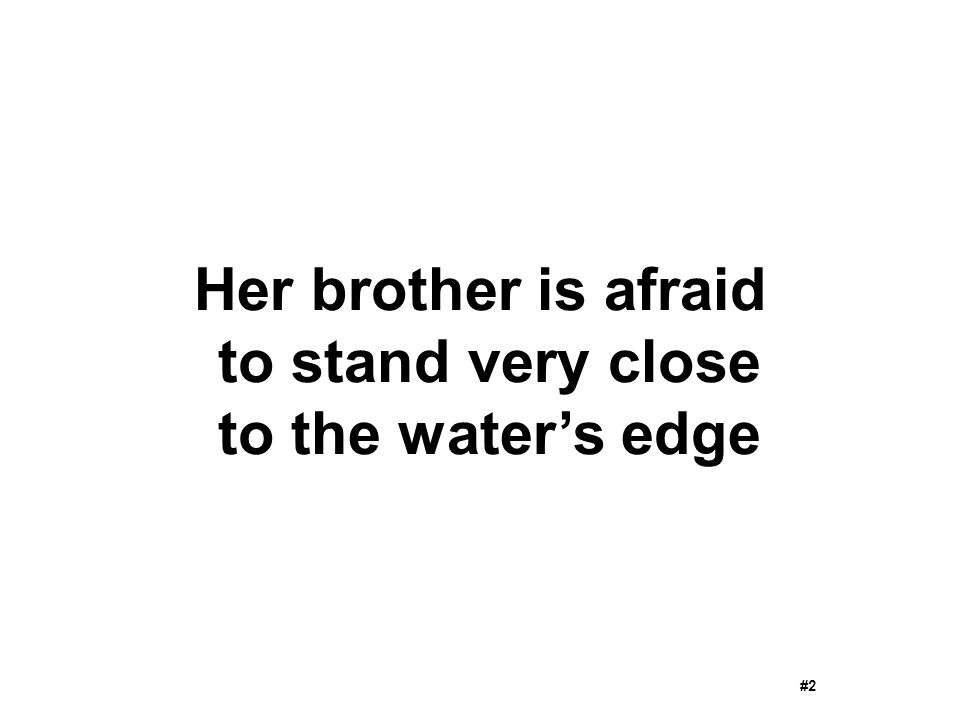 Her brother is afraid to stand very close to the water's edge