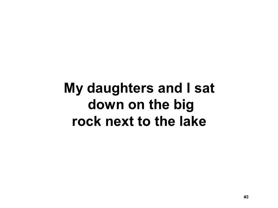 My daughters and I sat down on the big rock next to the lake
