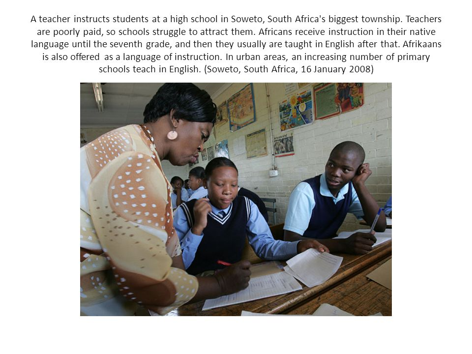 A teacher instructs students at a high school in Soweto, South Africa s biggest township.