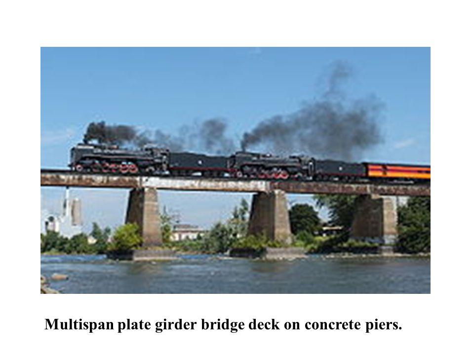 Multispan plate girder bridge deck on concrete piers.
