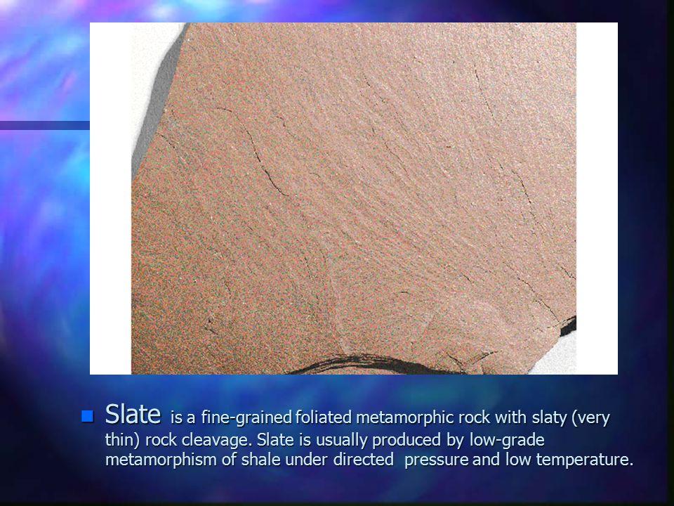 Slate is a fine-grained foliated metamorphic rock with slaty (very thin) rock cleavage.