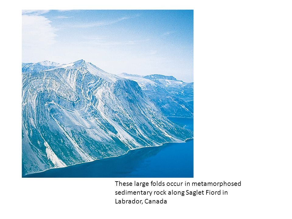 These large folds occur in metamorphosed sedimentary rock along Saglet Fiord in Labrador, Canada