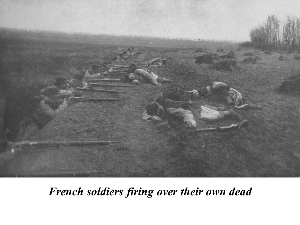 French soldiers firing over their own dead