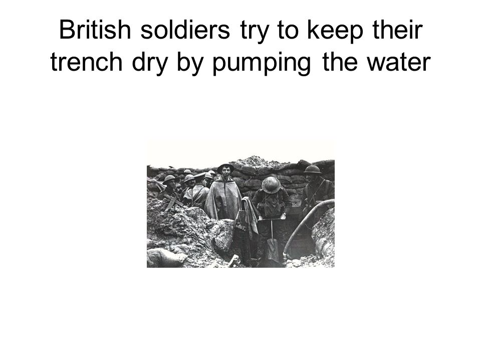 British soldiers try to keep their trench dry by pumping the water