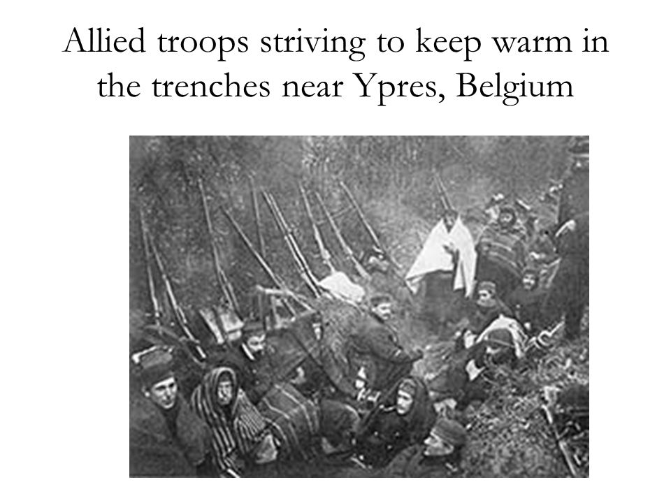 Allied troops striving to keep warm in the trenches near Ypres, Belgium
