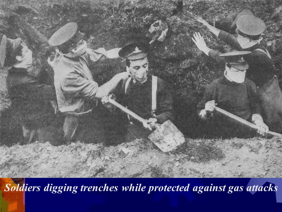 Soldiers digging trenches while protected against gas attacks