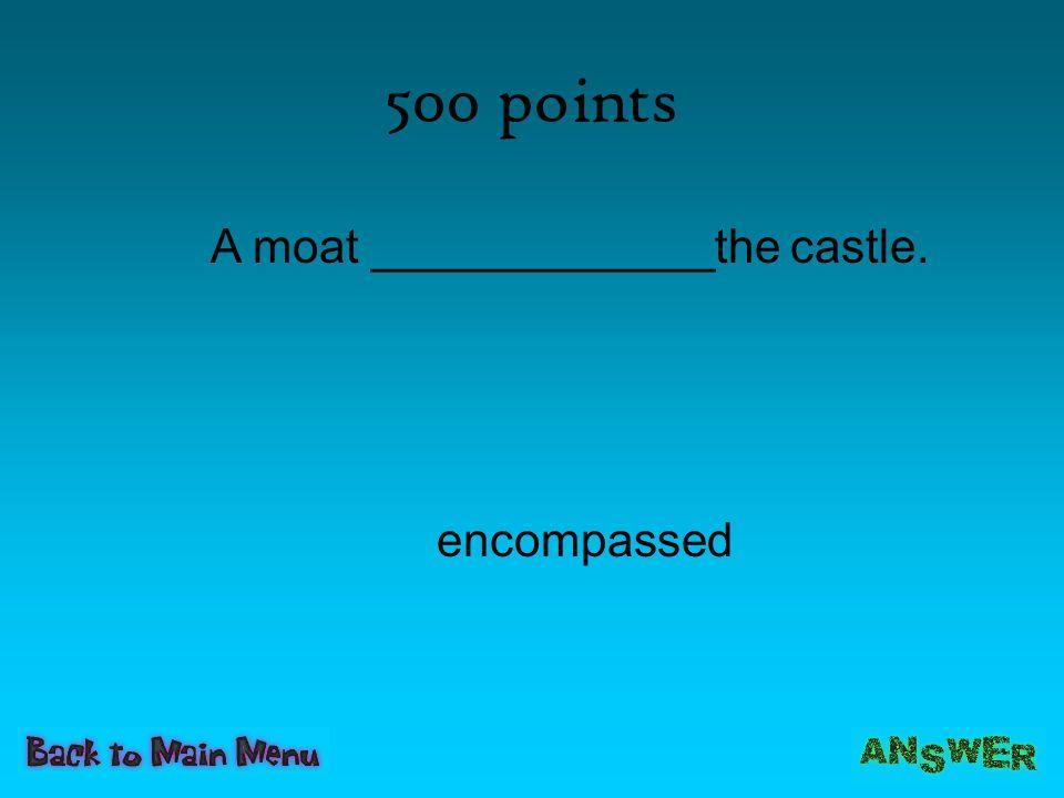 A moat _____________the castle.