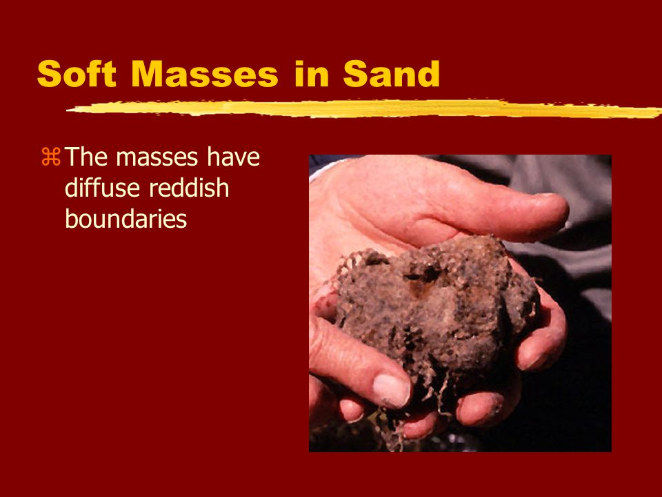 Soft Masses in Sand The masses have diffuse reddish boundaries