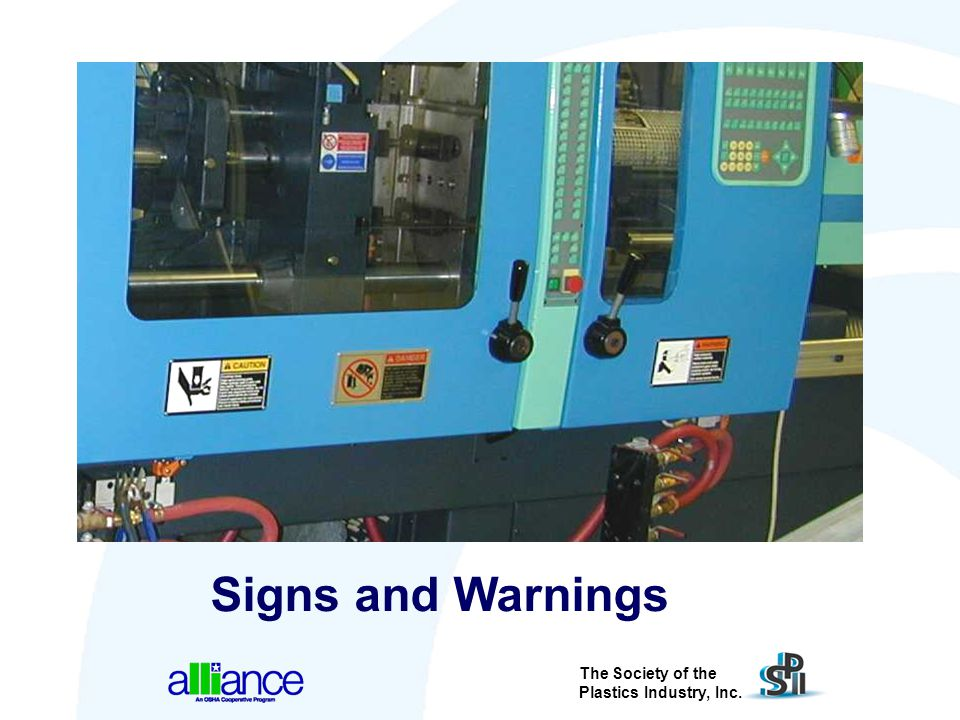 Signs are posted on a machine to inform us of hazardous areas