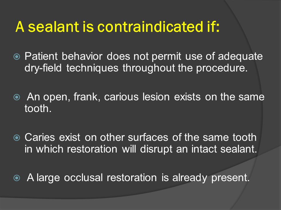 A sealant is contraindicated if: