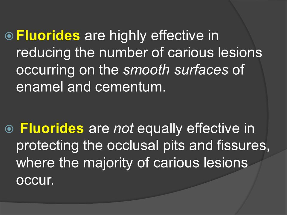 Fluorides are highly effective in reducing the number of carious lesions occurring on the smooth surfaces of enamel and cementum.