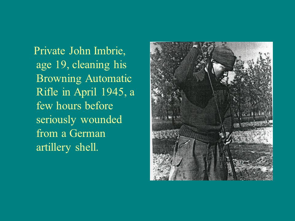 Private John Imbrie, age 19, cleaning his Browning Automatic Rifle in April 1945, a few hours before seriously wounded from a German artillery shell.