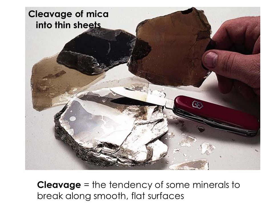 Cleavage of mica into thin sheets.