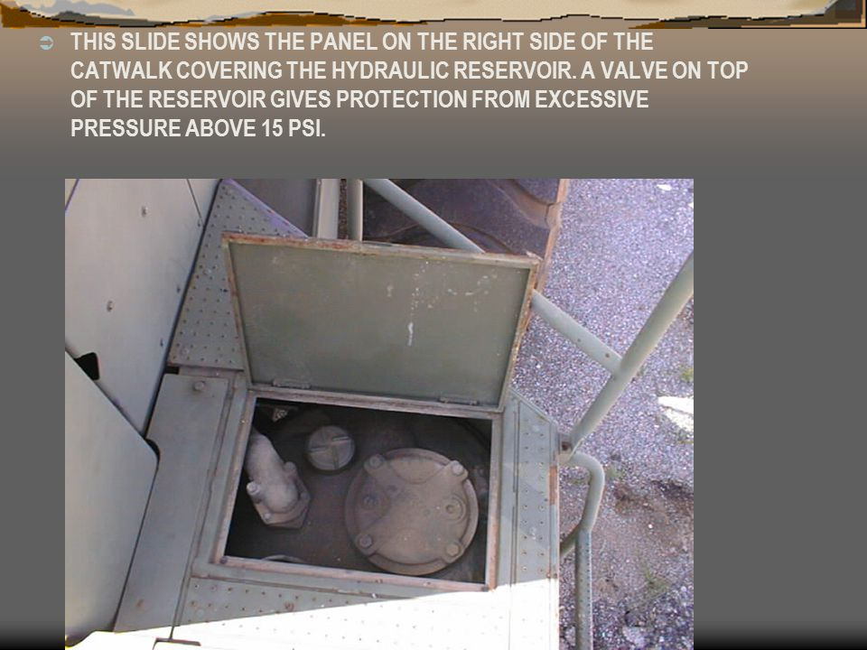 THIS SLIDE SHOWS THE PANEL ON THE RIGHT SIDE OF THE CATWALK COVERING THE HYDRAULIC RESERVOIR.