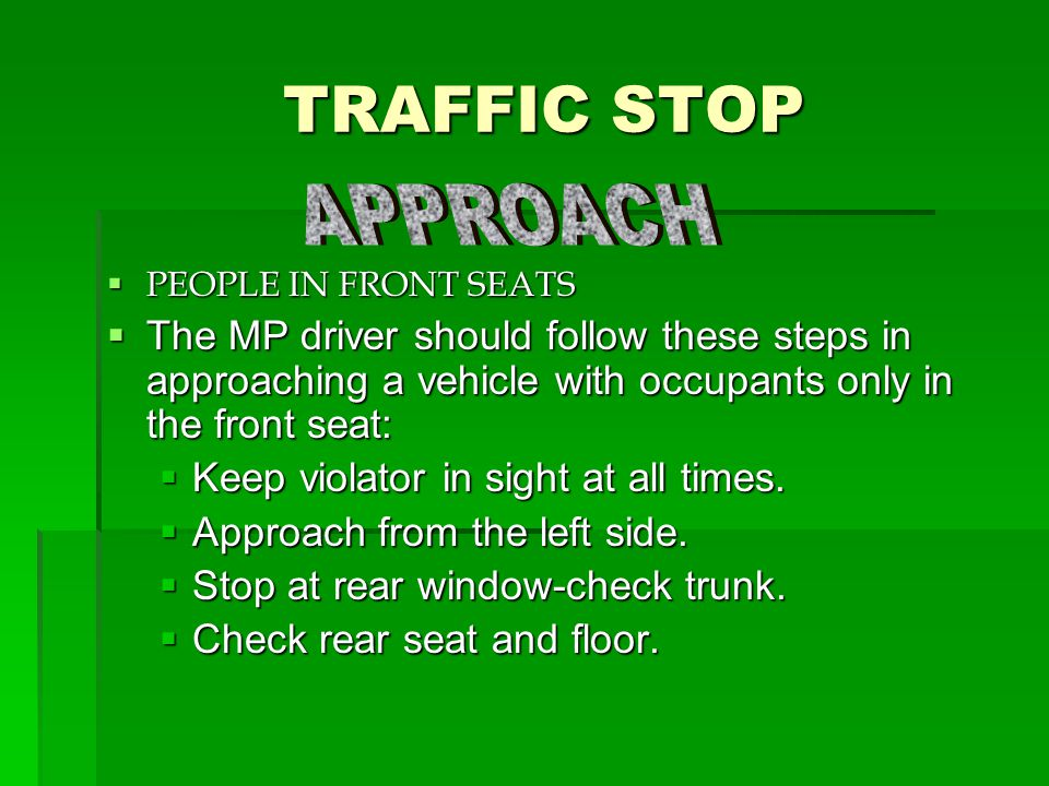 TRAFFIC STOP APPROACH. PEOPLE IN FRONT SEATS.