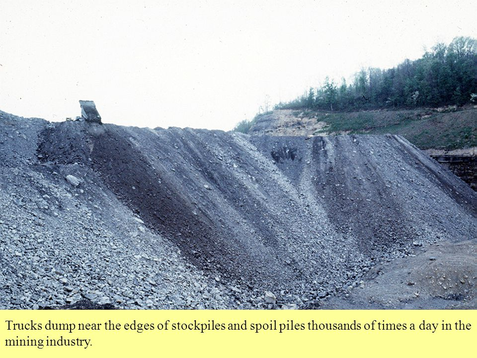 Trucks dump near the edges of stockpiles and waste piles thousands of times a day in the mining industry.