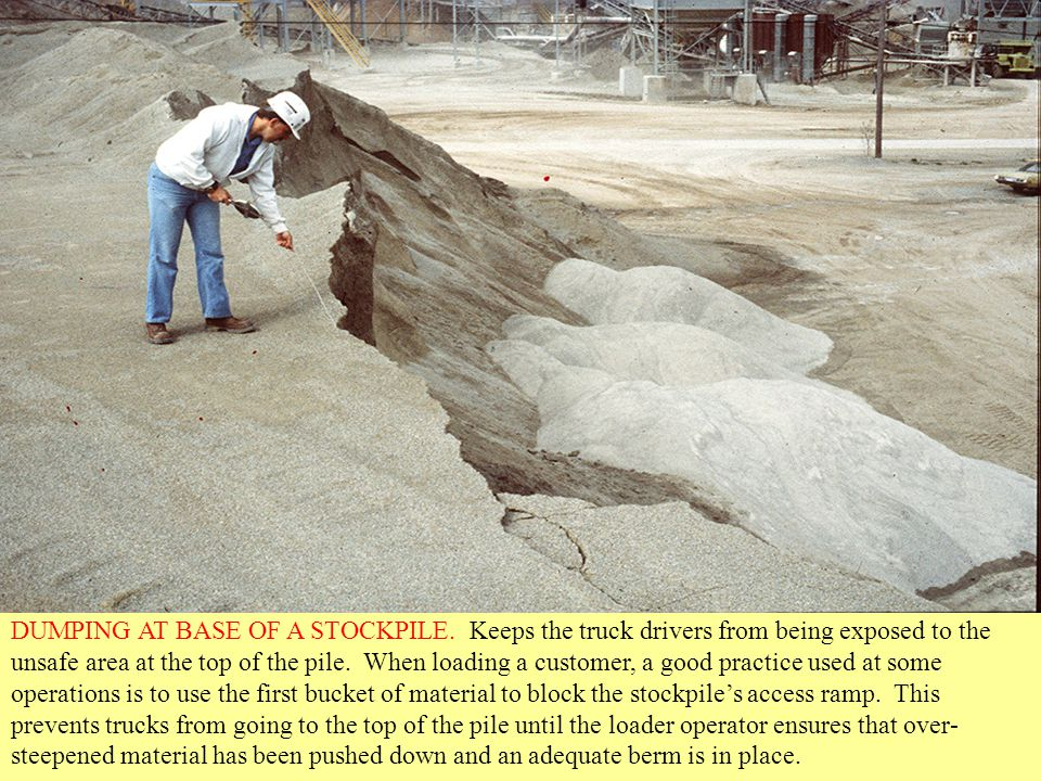 DUMPING AT BASE OF A STOCKPILE