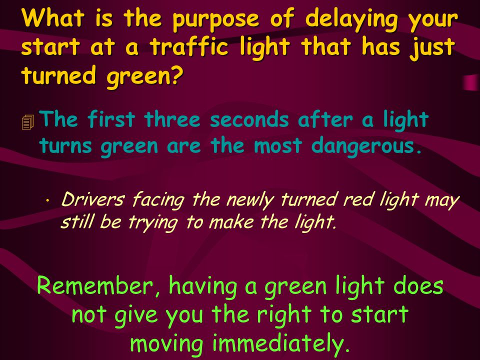 What is the purpose of delaying your start at a traffic light that has just turned green