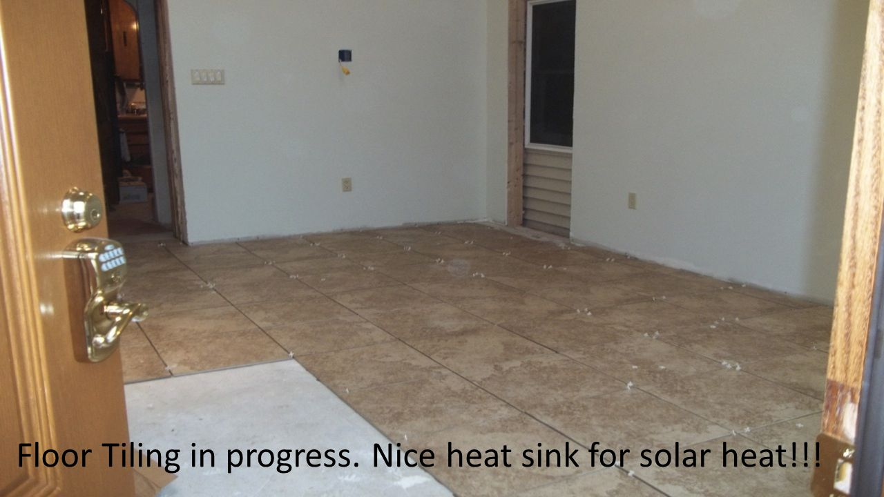 Floor Tiling in progress. Nice heat sink for solar heat!!!
