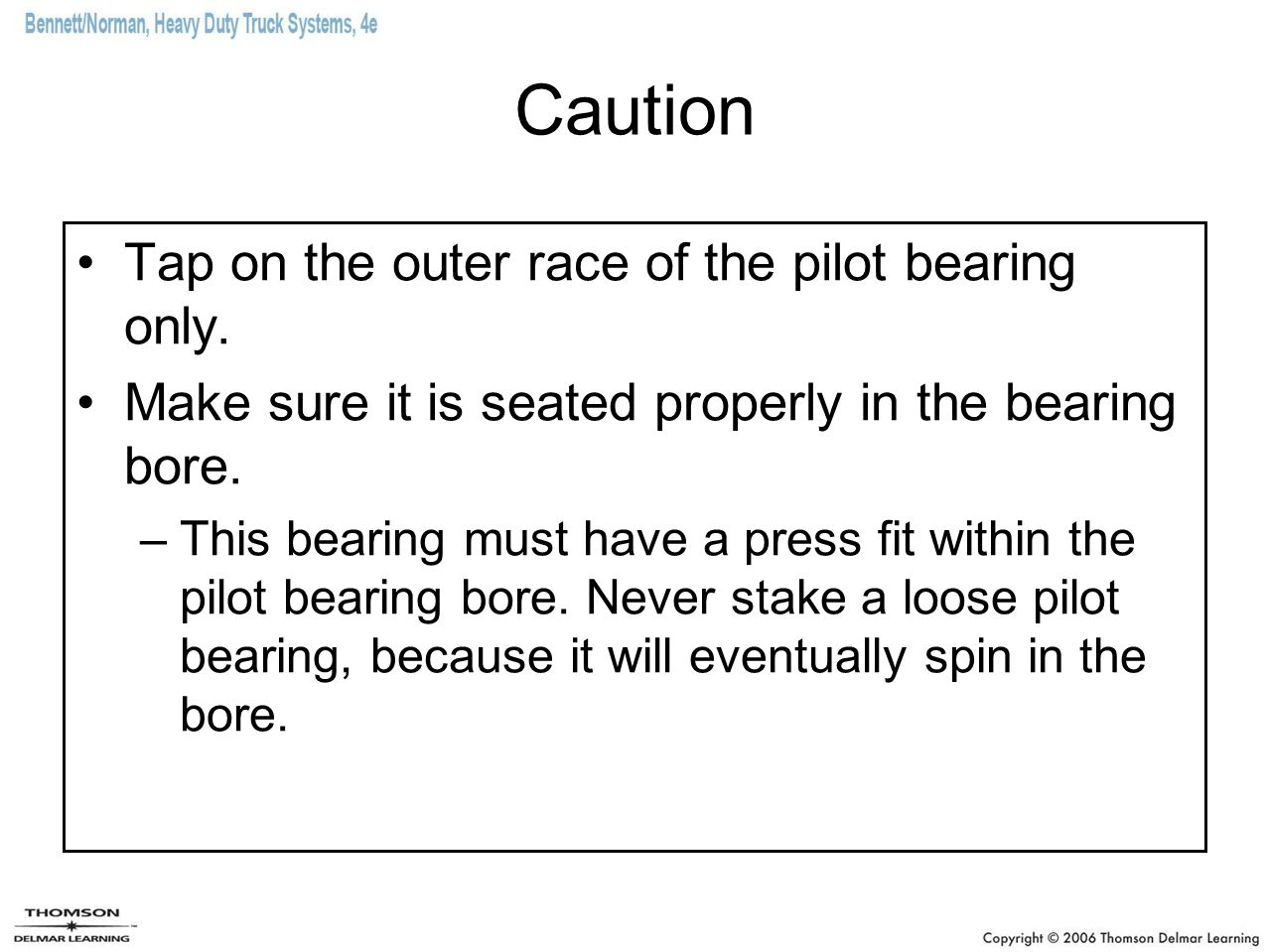 Caution Tap on the outer race of the pilot bearing only.