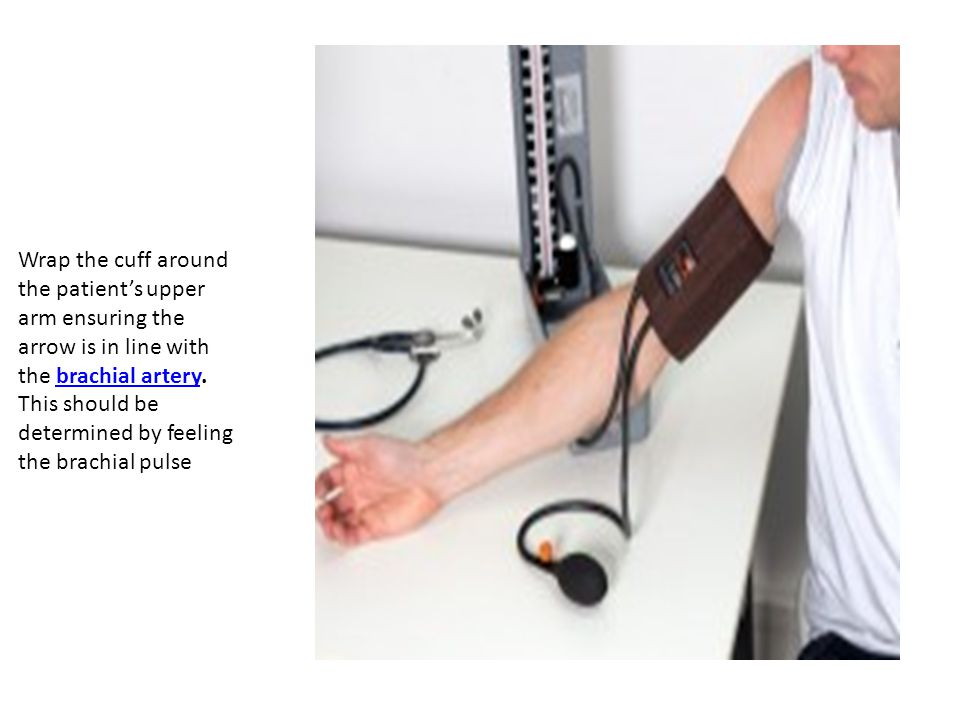 Wrap the cuff around the patient's upper arm ensuring the arrow is in line with the brachial artery.