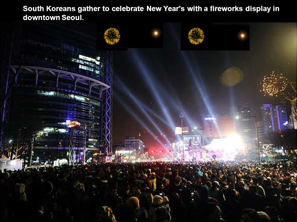 South Koreans gather to celebrate New Year s with a fireworks display in downtown Seoul.